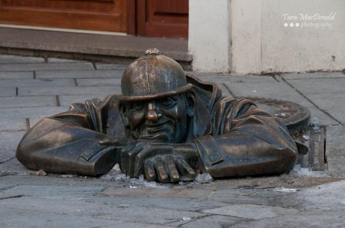 'Man at Work' - Čumil the Peeper by Viktor Hulík, 1997