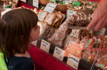 Child buying cookies at the Easter Market - Vienna, Austria